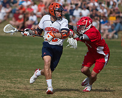 Virginia Cavaliers M/A John Haldy (12) is defended by Cornell Big Red M Roy Lang (48).  The #1 ranked Virginia Cavaliers defeated the #4 ranked Cornell Big Red 14-10 at Klockner Stadium on the Grounds of the University of Virginia in Charlottesville, VA on March 8, 2009.