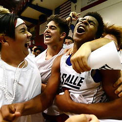 La Salle's Christian Oyie-Little, center, is mobbed by fans after defeating Campbell Hall 69-68 during a prep playoff semifinal basketball game at La Salle High School in Pasadena, Calif., on Friday, Feb. 26, 2016.