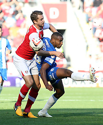 Peterborough United's Tyrone Barnett in action with Rotherham United's Kari Arnason - Photo mandatory by-line: Joe Dent/JMP - Tel: Mobile: 07966 386802 28/09/2013 - SPORT - FOOTBALL - New York Stadium - Rotherham - Rotherham United V Peterborough United - Sky Bet One