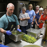 Lauren Wood | Buy at photos.djournal.com<br /> Mitch McCamey of KOK and Neon Pig gets ready to blanch rapini during the Cooking with Fresh Veggies class of the Mud and Magnolias Home and Garden Expo Saturday morning at the ICC Belden campus.