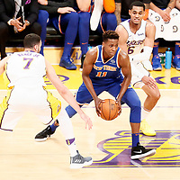 21 January 2018: New York Knicks guard Frank Ntilikina (11) drives past Los Angeles Lakers guard Jordan Clarkson (6) and Los Angeles Lakers forward Larry Nance Jr. (7) during the LA Lakers 127-107 victory over the New York Knicks, at the Staples Center, Los Angeles, California, USA.