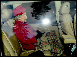 HM The Queen and The Duke of Edinburgh leaving after attending a church service on the Sandringham estate in Norfolk, United Kingdom. Sunday, 22nd December 2013. The Royal Family will spend Christmas at Sandringham. Picture by Andrew Parsons / i-Images