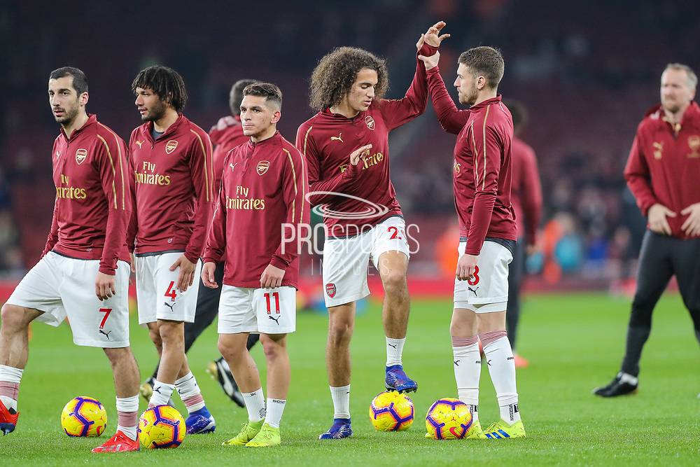 Arsenal midfielder Matteo Guendouzi (29) warms up with Arsenal midfielder Aaron Ramsey (8) during the Premier League match between Arsenal and Bournemouth at the Emirates Stadium, London, England on 27 February 2019.