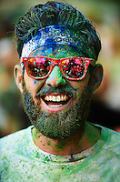 BARCELONA, SPAIN - MAY 18:  The Color Run by Desigual 2014 at Plaza de España on May 18, 2014 in Barcelona, Spain. (Photo by Manuel Queimadelos)