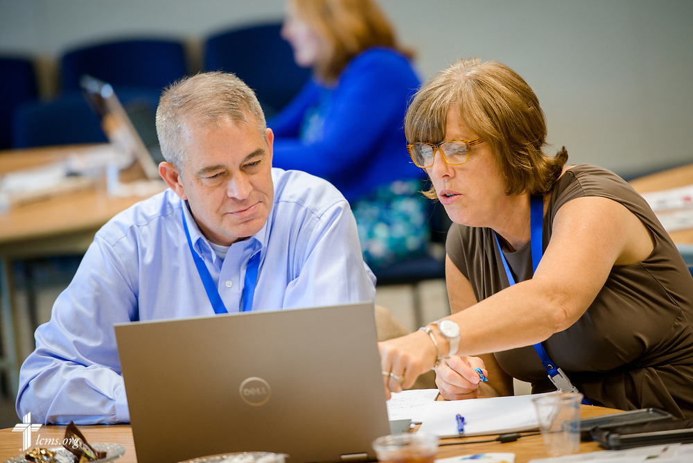 New missionaries Karen and Carl Cecil work on their presentation during missionary orientation at the International Center of The Lutheran Church–Missouri Synod on Wednesday, July 12, 2017, in St. Louis.  LCMS Communications/Erik M. Lunsford