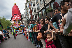 © licensed to London News Pictures. London, UK 17/06/2012. People pulling a 40-foot high colourful chariot as they celebrating Hare Krishna, an old Hindu tradition in central London, today (17/06/12). Photo credit: Tolga Akmen/LNP