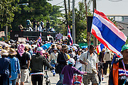 22 DECEMBER 2013 - BANGKOK, THAILAND:  The scene on the street that leads to the home of caretaker Prime Minister Yingluck Shinawatra. Hundreds of thousands of Thais gathered in Bangkok Sunday in a series of protests against the caretaker government of Yingluck Shinawatra. The protests are a continuation of protests that started in early November and have caused the dissolution of the Pheu Thai led government of Yingluck Shinawatra. Protestors congregated at home of Yingluck and launched a series of motorcades that effectively gridlocked the city. Yingluck was not home when protestors picketed her home.    PHOTO BY JACK KURTZ