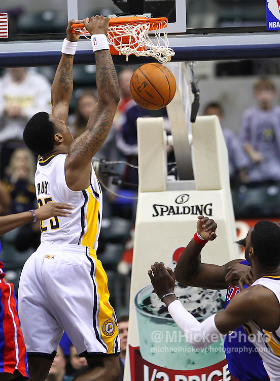 Feb. 23, 2011; Indianapolis, IN, USA; Indiana Pacers guard Brandon Rush (25) slams the game winning basket against the Detroit Pistons at Conseco Fieldhouse. Indiana defeated Detroit 102-101. Mandatory credit: Michael Hickey-US PRESSWIRE