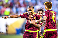 Venezuelan striker Salomon Rondon, left, celebrates with teammate Josef Martinez, center, and Adalberto Peñaranda, after scoring the only goal of the Venezuelan 1-0 victory over Uruguay in a group stage match for the Copa America Centenario at Lincoln Financial Field in Philadelphia, Penn., on Friday June 9, 2016.