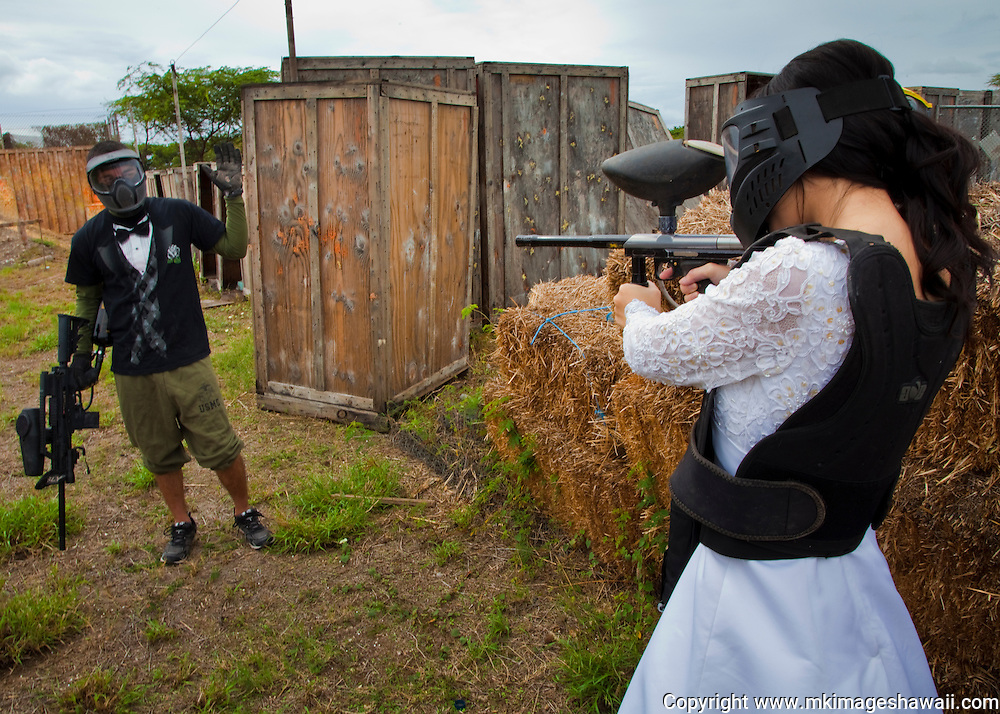 Do a photoshoot at a paintball course in a wedding gown...and there just so happens to be some guy there in a tuxedo shirt. What are the odds?