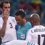 Uruguay Defender DIEGO GODIN (3), left, pleads his case to case the official in the first half of a Copa America Centenario Group C match between Uruguay and Venezuela Thursday, June. 09, 2016 at Lincoln Financial Field in Philadelphia, PA.