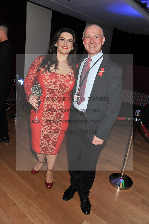 DAVID PENDLEBURY Chairman of the Make A Difference Trust and JODIE PRENGER at West End Eurovision 2013 held at the  Dominion Theatre, London on 23rd May 2013.