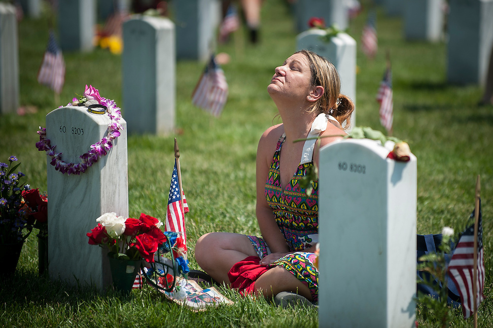 Lauura Youngblood weeps over the grave of her husband Travis L. Youngblood at section 60 in Arlington National Cemetery on Memorial Day at Arlington National Cemetery in Arlington, Virginia, USA, on 26 May 2014. Laura Youngblood is also a veteran of the United States Navy. Her husband was killed during the Iraq War.
