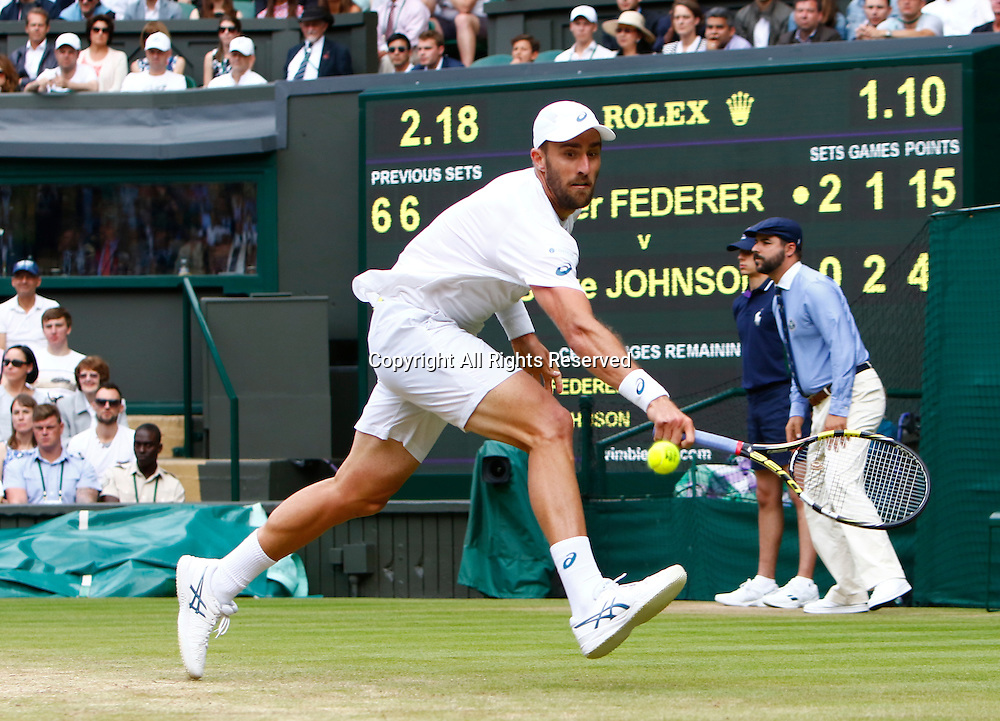 04.07.2016. All England Lawn Tennis and Croquet Club, London, England. The Wimbledon Tennis Championships Day 8.  Steve Johnson (USA) hits a backhand during his singles match against number 3 seed, Roger Federer (SUI).