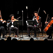May 14, 2011 - Manhattan, NY : .The Harlem Quartet, comprised of Ilmar Gavilan and Melissa White (violins), Juan-Miguel Hernandez (viola) and Paul Wiancko (cello), performs the world premiere of Tania Leon's 'Cuarteto No. 2' performs during Symphony Space's Wall to Wall Sonidos concert on Saturday night. .CREDIT: Karsten Moran for The New York Times