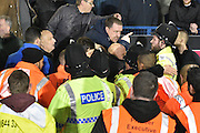 Bradford City Fans clash with the police  and stewards during the The FA Cup third round match between Bury and Bradford City at Gigg Lane, Bury, England on 9 January 2016. Photo by Mark Pollitt.