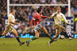 Stephen Jones (Wales) chips past Mathew Tait (England) as Jonny Wilkinson (L-England) looks on during the RBS 6 Nations Championship match between England and Wales at Twickenham Stadium on February 6, 2010 in London, England.