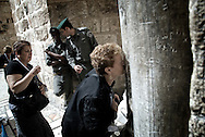 Christian pilgrim kisses a stone outside The Holy Sepulchr's Church, on april 2, 2010.