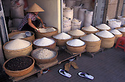 Rice vendors in market, Ho Chi Minh City, Vietnam