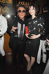 ROBERTO CAVALLI and singer SOPHIE ELLIS-BEXTOR at a party to celebrate the launch of Cavalli Selection - the first ever wine from Casa Cavalli, held at 17 Berkeley Street, London W1 on 29th May 2008.<br />