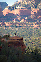 Woman pausing on the Devils Bridge Trail Sedona Arizona USA&#xA;<br />