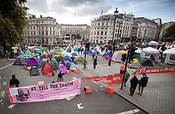© Licensed to London News Pictures. 09/10/2019. London, UK. Extinction Rebellion activists camp out in Trafalgar Square as they take part in a third day of protests in central London. The climate change group intend to blockade the Westminster area for two weeks to demand that the government takes immediate and decisive action on climate change. Photo credit: Peter Macdiarmid/LNP
