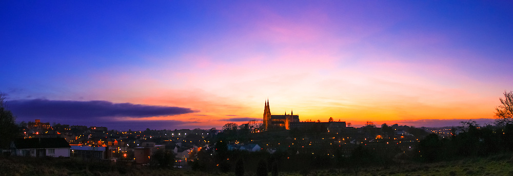 Sunset overlooking Armagh from Armagh Observatory Astropark, with (from left) St. Patrick's protestant and Roman Catholic Cathedrals on the horizon
