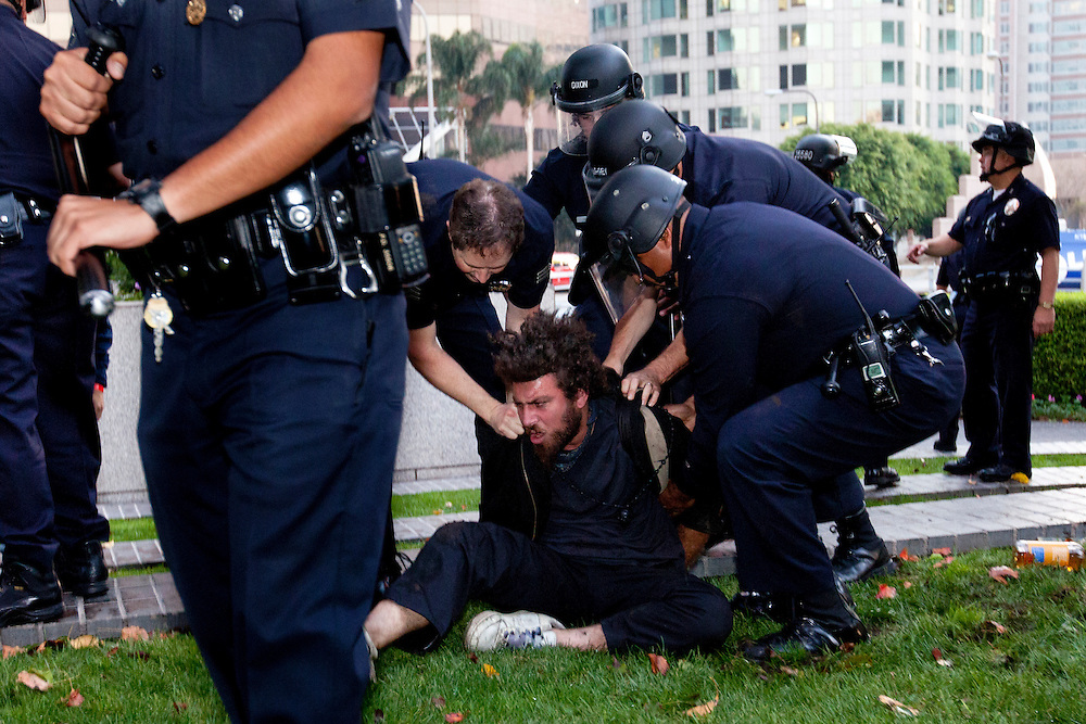 A man is tackled and arrested by Los Angeles police for disorderly conduct at Bank of America plaza in Los Angeles, Calif. on Thursday, November 17, 2011. (Photo by Gabriel Romero ©2011)