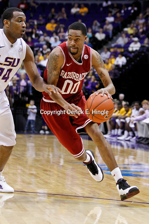 February 4, 2012; Baton Rouge, LA; Arkansas Razorbacks guard Rashad Madden (0) against the LSU Tigers during the second half of a game at the Pete Maravich Assembly Center. LSU defeated Arkansas 71-65.  Mandatory Credit: Derick E. Hingle-US PRESSWIRE