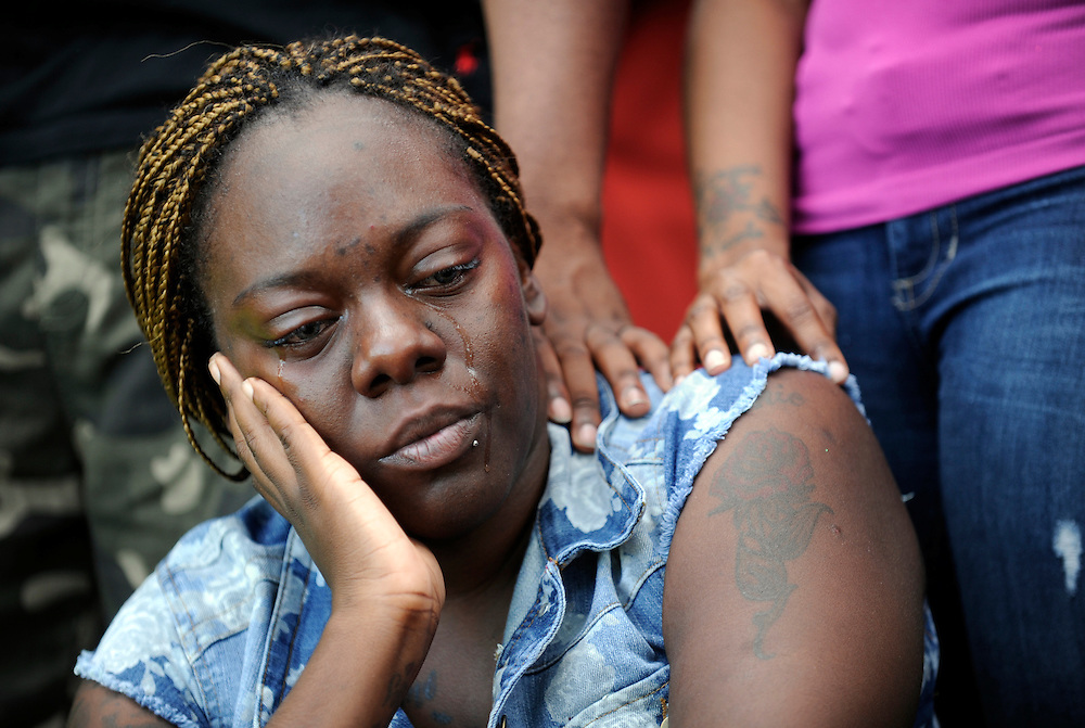 Alicia Sanders, the mother of Armani Pierce, is consoled as she takes a moment to reflect during a prayer vigil Wednesday, Aug. 14, 2013 in the Temple Crest area of Tampa. Armani Pierce's body was found Wednesday morning after an 11-hour search at Temple Crest Park.