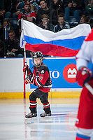 KELOWNA, CANADA - NOVEMBER 9: Connor Vogt skates with the Russian flag during opening ceremonies  on November 9, 2015 during game 1 of the Canada Russia Super Series at Prospera Place in Kelowna, British Columbia, Canada.  (Photo by Marissa Baecker/Western Hockey League)  *** Local Caption *** Connor Vogt;