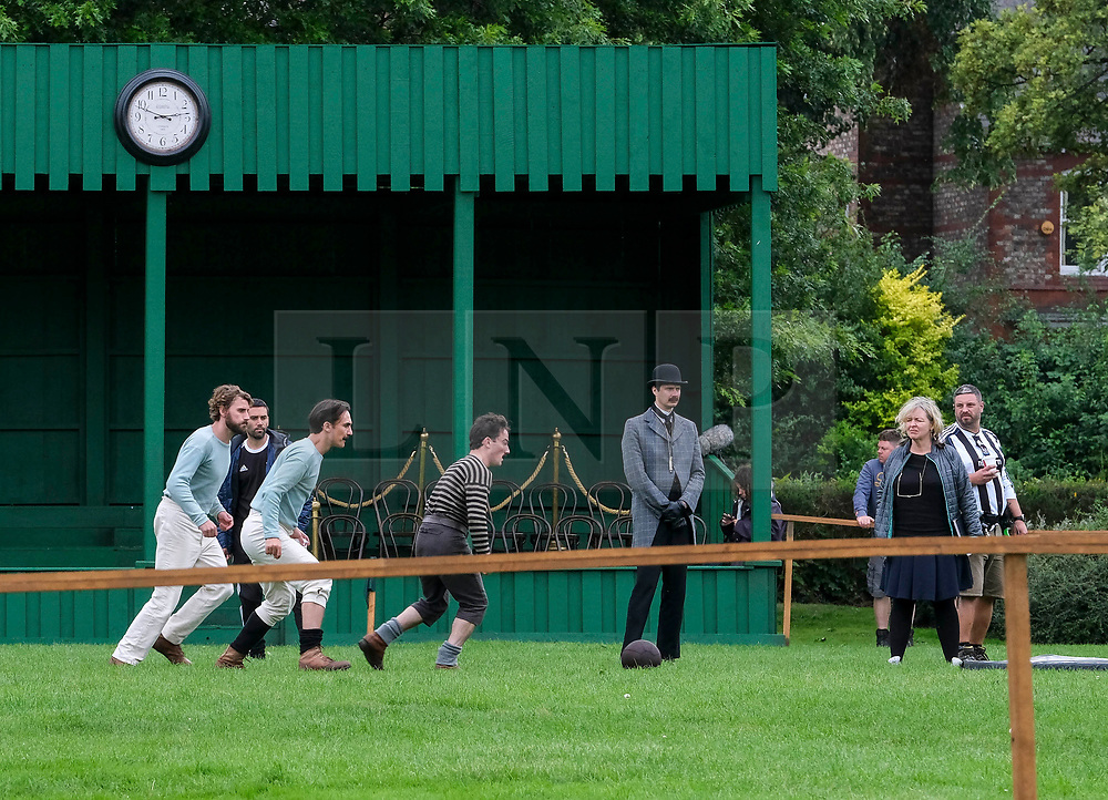 © Licensed to London News Pictures. 11/08/2019. Manchester, UK. Actor EDWARD HOLCRFT (white trousers, blue top) takes part in filming in Manchester for the new TV series The English game, a six part series about the story of the invention of football. Photo credit: Stephen Cottrill/LNP