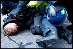 Police officers arrest an anti-EDL protester who tried to break the police line as the EDL protest against what the EDL sees as the influence of Islam in the Tower Hamlets area of London, United Kingdom. Saturday, 7th September 2013. Picture by Piero Cruciatti / i-Images