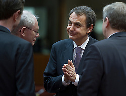 Jose Zapatero, Spain's prime minister, center, speaks with Herman Van Rompuy, president of the European Council, left, and Yves Leterme, Belgium's prime minister, during the European Summit, in Brussels, on Friday, March 26, 2010. (Photo © Jock Fistick)