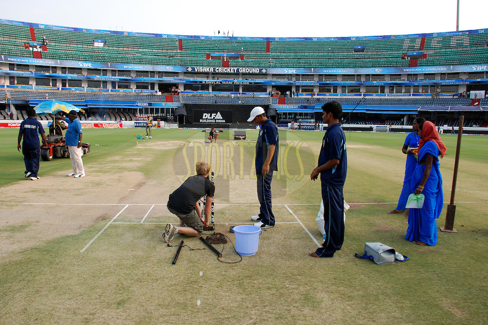 Tv setup and ground staff watching it during match 11 of the Indian Premier League ( IPL ) between the Deccan Chargers and the Royal Challengers Bangalore held at the Rajiv Gandhi International Cricket Stadium in Hyderabad on the 14th April 2011..Photo by Saikat Das/BCCI/SPORTZPICS