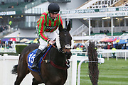 Movie Legend and jockey Leighton Aspell on their way to the start for the 4.40pm The Close Brothers Red Rum Handicap Steeple Chase (Grade 3) 2m during the Grand National Festival Week at Aintree, Liverpool, United Kingdom on 4 April 2019.