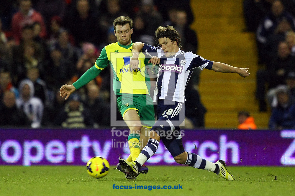 Picture by Paul Chesterton/Focus Images Ltd +44 7904 640267<br /> 07/12/2013<br /> Jonny Howson of Norwich and Billy Jones of West Brom in action during the Barclays Premier League match at The Hawthorns, West Bromwich.