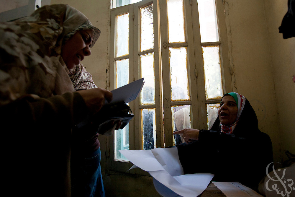 Egyptian women vote in historic free parliamentary elections Nov 28, 2011 at a polling station in the Shubra district of the capital, Cairo. The first round of voting (1 of three) for the election, the first since the revolution in Egypt that ousted former president Hosni Mubarak earlier in the year, saw very high voter turnout and is hoped to be a positive step in the direction of a new democratic spirit for the country. (Photo by Scott Nelson)