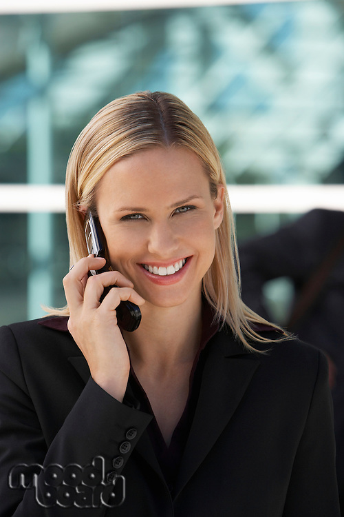 Businesswoman using mobile phone outside