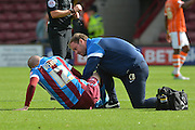 Neil Bishop  injured during the Sky Bet League 1 match between Scunthorpe United and Blackpool at Glanford Park, Scunthorpe, England on 5 September 2015. Photo by Ian Lyall.