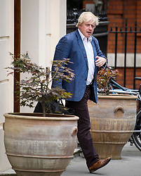 © Licensed to London News Pictures. 12/07/2018. London, UK. Former Foreign Secretary BORIS JOHNSON seen leaving his London home on the day the the government white paper was released, setting out full details of the Chequers plan for Brexit. Foreign secretary Boris Johnson and Brexit secretary David Davis resigned earlier this week in protest at the plans, which are seen by some as a betraying of the referendum result. Photo credit: Ben Cawthra/LNP