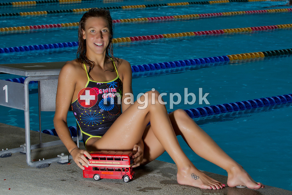 Swimmer Swann OBERSON of Switzerland poses with a model of a London bus during a portrait session after her training session at the outdoor swimming pool (Piscina Comunale) in Bellinzona, Switzerland, Friday, July 20, 2012. (Photo by Patrick B. Kraemer / MAGICPBK)