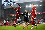 Liverpool striker Sadio Mane (10) heads the ball with Liverpool defender Dejan Lovren (6) also waiting  during the Premier League match between Liverpool and Newcastle United at Anfield, Liverpool, England on 26 December 2018.