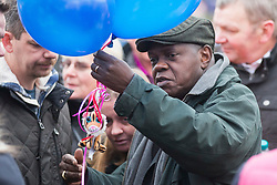 © Licensed to London News Pictures. 16/01/2017. York UK. Picture shows the Arch Bishop of York with balloons ready to release as Katie Rough's parents Paul & Alison Rough where joined by hundreds of people in Westfield Park in York this afternoon to release balloons on what would have been Katie's 8th birthday. Katie died last week after being found with significant cuts to her neck & chest.  Photo credit: Andrew McCaren/LNP