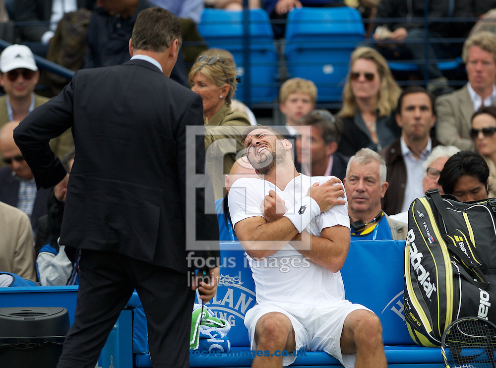 Viktor Troicki of Serbia shows discomfort after falling heavily on his shoulder during his semi-final match against Andy Murray of Great Britain in Aegon Championships at the Queen's Club, West Kensington<br /> Picture by Alan Stanford/Focus Images Ltd +44 7915 056117<br /> 20/06/2015