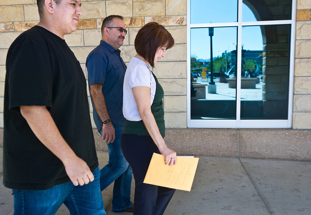 mkb042017c/metro/Marla Brose --  Bernadette Salas-Montano, right, leaves the Bernalillo County Courthouse with her son Alan Montano, Jr., left, and her husband Alan Montano, Sr., second from left, after seeing District Judge Alan Malott to change the name on her birth certificate, Thursday, April 20, 2017, in Albuquerque, N.M. (Marla Brose/Albuquerque Journal)