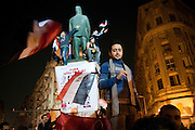 Egyptians in Cairo's Talaat Harb Square celebrate the just-announced resignation of their president of 30 years, Hosni Mubarak. This brought an end to 18 days of protest in which some 300 people lost their lives. (Cairo, Egypt - February 11, 2011)