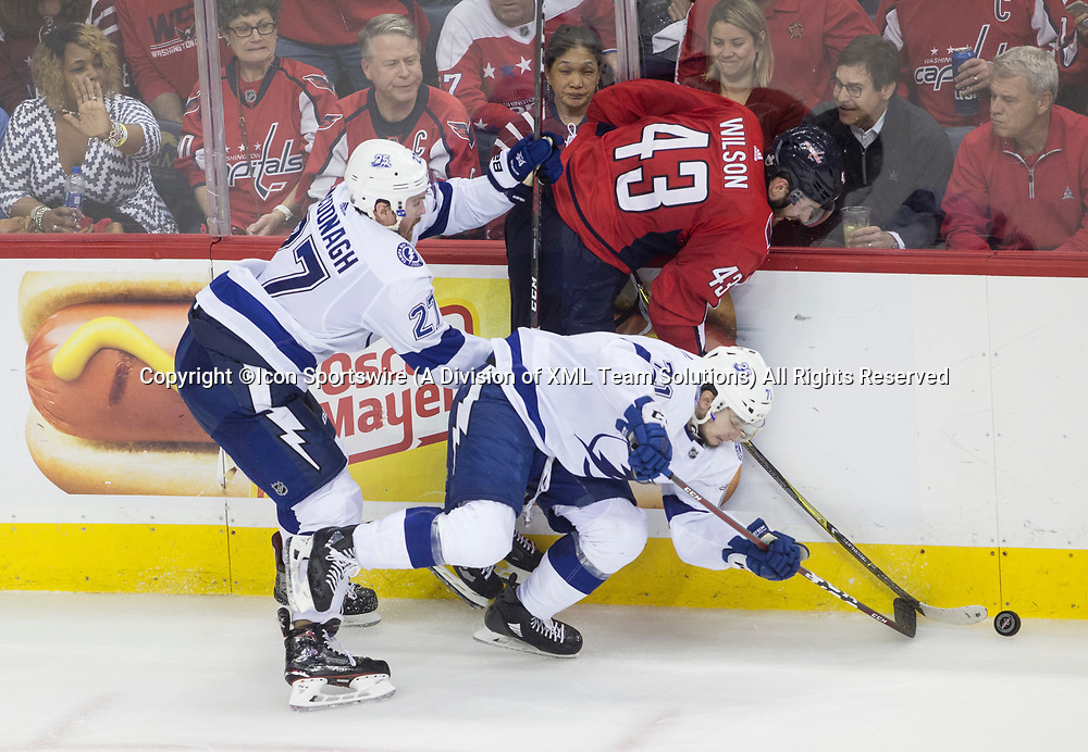 WASHINGTON, DC - MAY 21: Washington Capitals right wing Tom Wilson (43) jammed into the boards by Tampa Bay Lightning defenseman Ryan McDonagh (27) and center Anthony Cirelli (71) during game 6 of the NHL Eastern Conference  Finals between the Washington Capitals and the Tampa Bay Lightning, on May 21, 2018, at Capital One Arena, in Washington D.C. The Caps defeated the Lightning 3-0<br /> (Photo by Tony Quinn/Icon Sportswire)