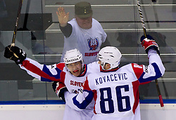 Bostjan Golicic of Slovenia and Sabahudin Kovacevic of Slovenia celebrate during ice-hockey match between Russia and Slovenia of Group A of IIHF 2011 World Championship Slovakia, on May 1, 2011 in Orange Arena, Bratislava, Slovakia. Russia defeated Slovenia 6-4. (Photo By Vid Ponikvar / Sportida.com)