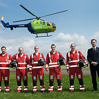 SCAA..Scotland's Charity Air Ambulance paramedics pictured with Helimed 76 at the base in Perth, pictured from left, Alex Holden, Bruce Rumgay, John Pritchard, Wayne Auton, Andy Walker and SCAA Chairman John Bullough<br /> The helicopter is a Bolkow 105 supplied by Bond Aviation Services.<br /> Picture by Graeme Hart.<br /> Copyright Perthshire Picture Agency<br /> Tel: 01738 623350  Mobile: 07990 594431
